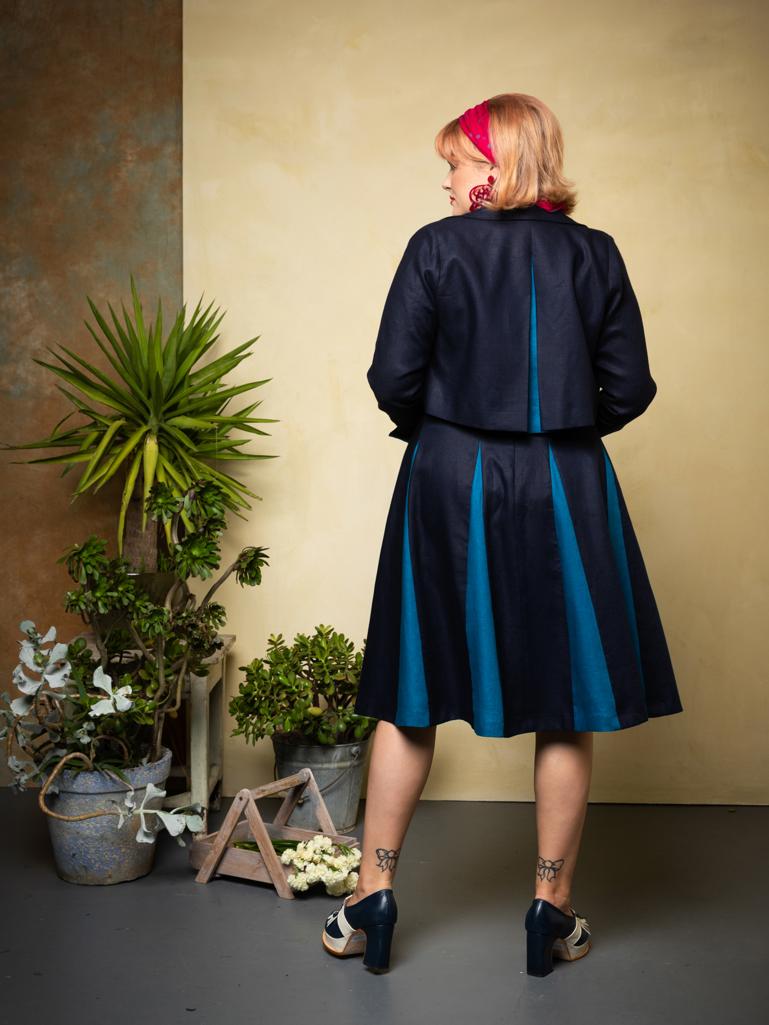 Sorrento Jkt. & Roman Holiday Skirt.navy.peacock.back. web